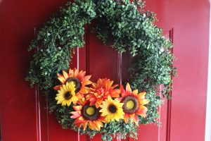 green wreath with fall flowers
