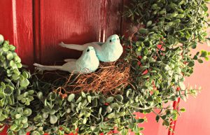 green wreath with blue birds in nest