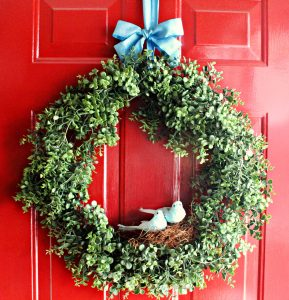 simple green wreath with blue birds and nest