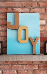 JOY letters on canvas