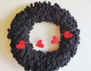 Black yarn wreath with hearts