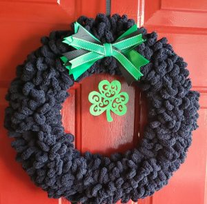 black yarn wreath with shamrocks
