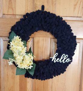 black yarn hello wreath