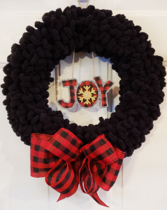 joy yarn wreath white door